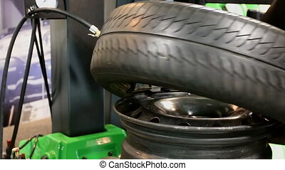 Repair and change of tires tyre - Tire tyre being mounted on...