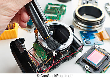 Repair broken digital SLR camera in service