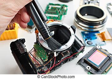 Repair broken digital SLR camera in service