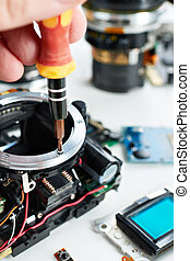 Repair broken DSLR camera in service
