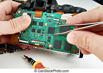 Repair broken photo DSLR camera in service