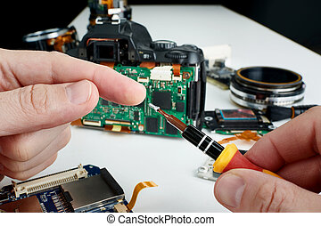 Repair broken photo DSLR camera in service