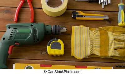 repair, building and carpentry concept - different work tools on wooden boards