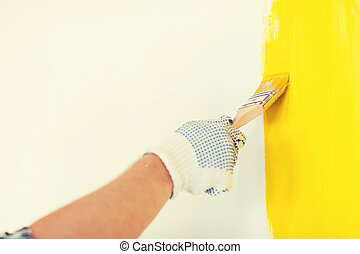 close up of male in gloves holding paintbrush - repair, ...