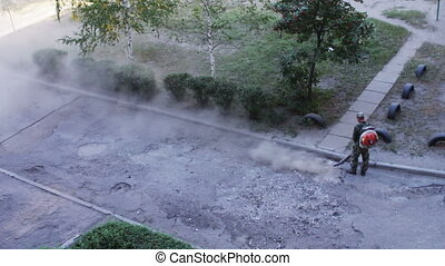 Repair crews repair the road and put new asphalt.