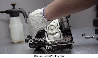 Repair Element of Automatic Car Transmission at Workshop