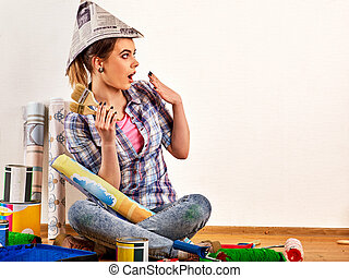 Repair home woman holding paint brush for wallpaper.