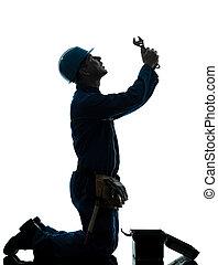 repair man worker despair praying silhouette
