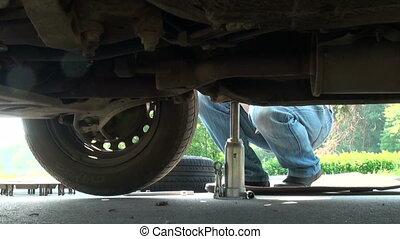 Repair of car - Jack, car repair on the journey, wheel...