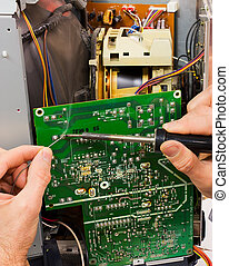 repair of circuit board - technician repairs electronic...