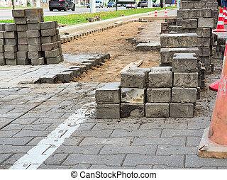 Repair of paving slabs in a city in Russia
