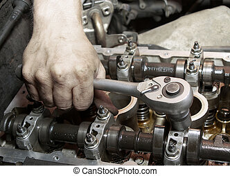 Repair of the engine. A hand with the tool. Automobile...