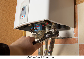 repair of the gas water heater with adjustable wrench
