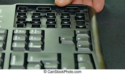 Repair of the keyboard - Hands put the keyboard body with...