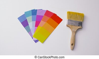 paint brush and color palette on white background