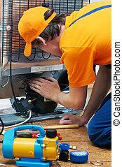 repair work on fridge appliance - Repairman makes ...