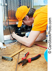 repair work on fridge appliance - Repairman makes...