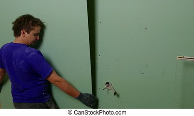 Repairer Make Install Drywall using Screwdriver and Screw