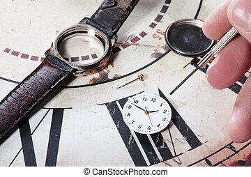 repairing clock - human repairing an old and broken clock