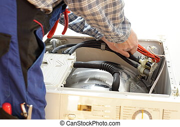 repairing close up - electrician working on a open washing...
