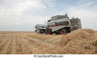 repairing combine harvester