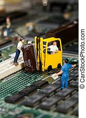 Repairing Electronic Circuitry. A miniature model figurine...
