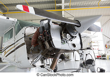 Repairing small propeller airplane - Small two-seated...