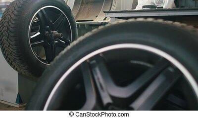 Repairing tires in car service - mechanical workshop, close...
