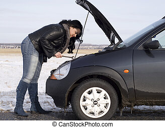 repairing - woman with her broken car