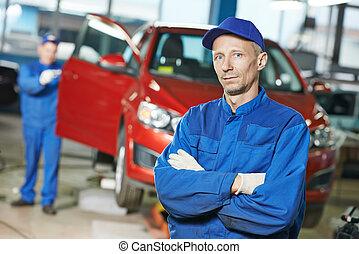 Repairman auto mechanic at workshop