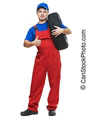 repairman automobile mechanic with car tire