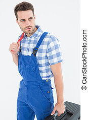 Repairman carrying toolbox while looking asway