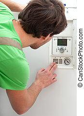 Repairman fixing a boiler