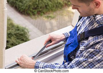 Repairman Fixing Window - Close-up Of A Repairman's Hand...