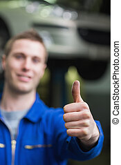 Repairman gesturing thumbs up