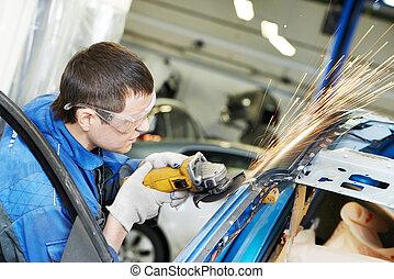 repairman grinding metal body car - professional repairman ...