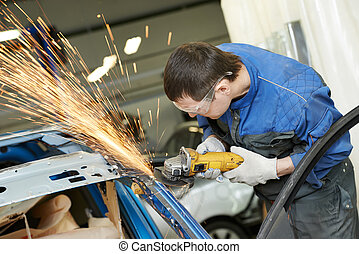 repairman grinding metal body car - professional repairman...