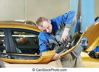 repairman grinding metal body car