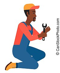 Repairman holding spanner. - Young african-american ...