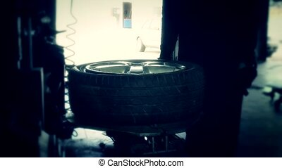 repairman mounting tire and inflate air with electric...