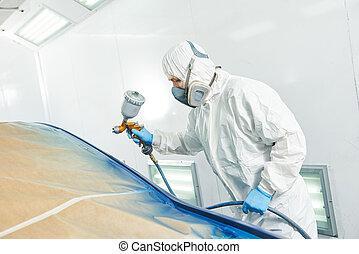 repairman painter in chamber painting automobile car bumper...