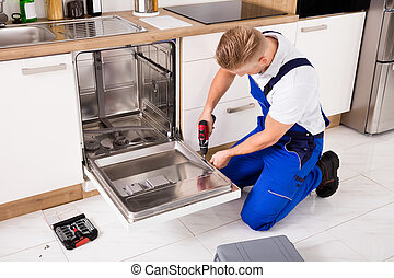 Repairman Repairing Dishwasher