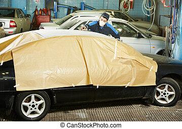 repairman sanding car roof