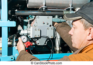 repairman using manometer - serviceman repairman measuring...