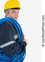 Repairman wearing hardhat with cable