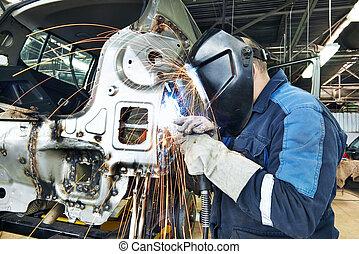 repairman welding metal body car - professional repairman...