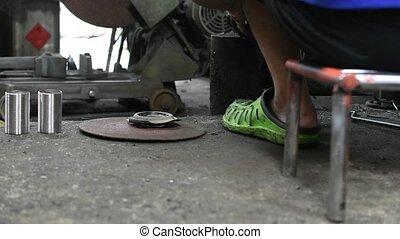 Repairman working for welding car coil spring (car...