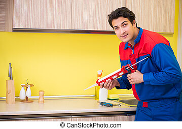 Repairman working in the kitchen