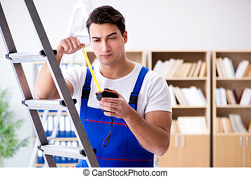 Repairman working with measurement tape