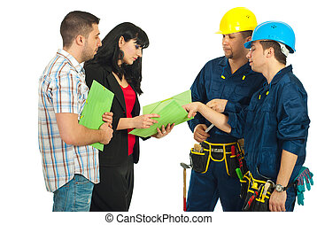 Repairmen team discuss  with couple
